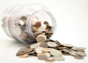 Money in a jar on its side